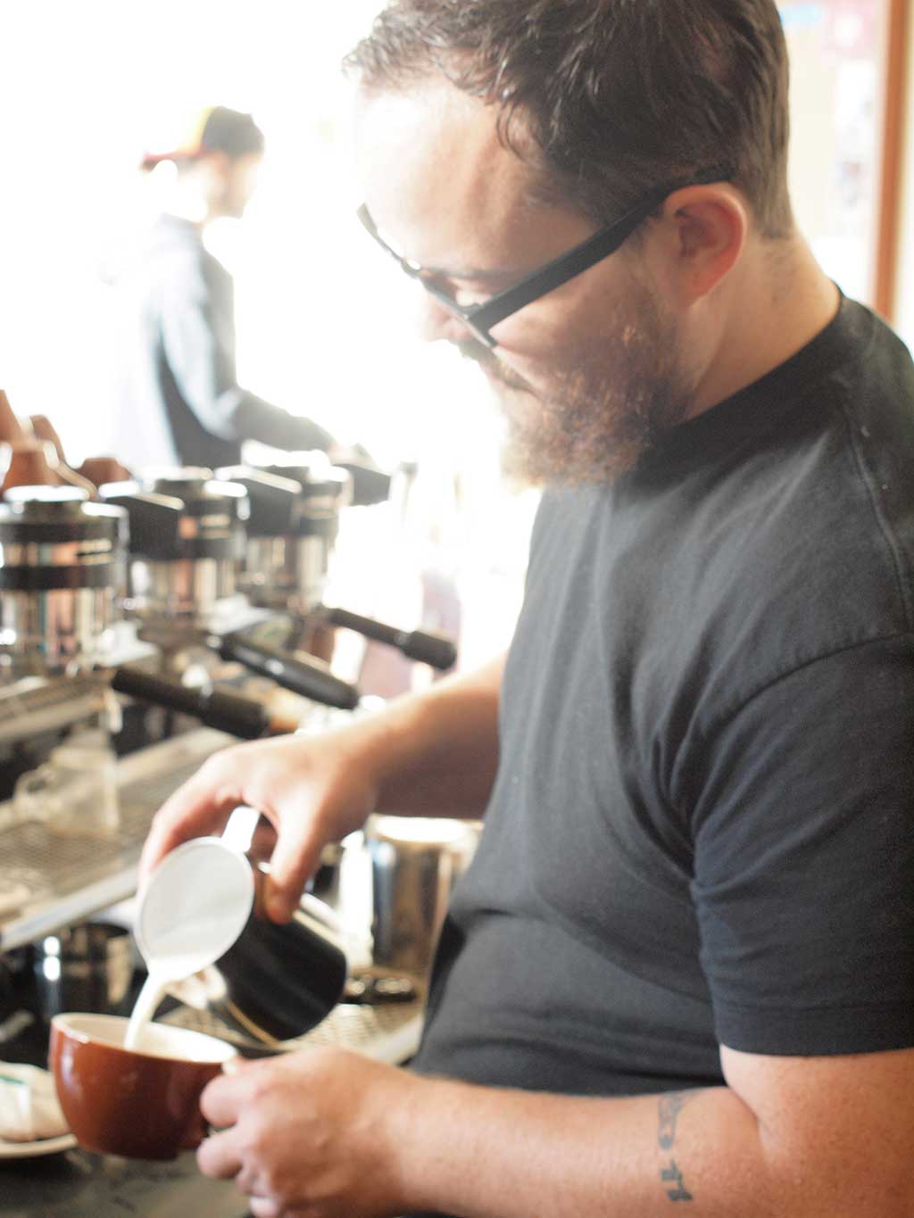 Pouring coffee at Case Study Coffee on Albert Street in Portland, Oregon