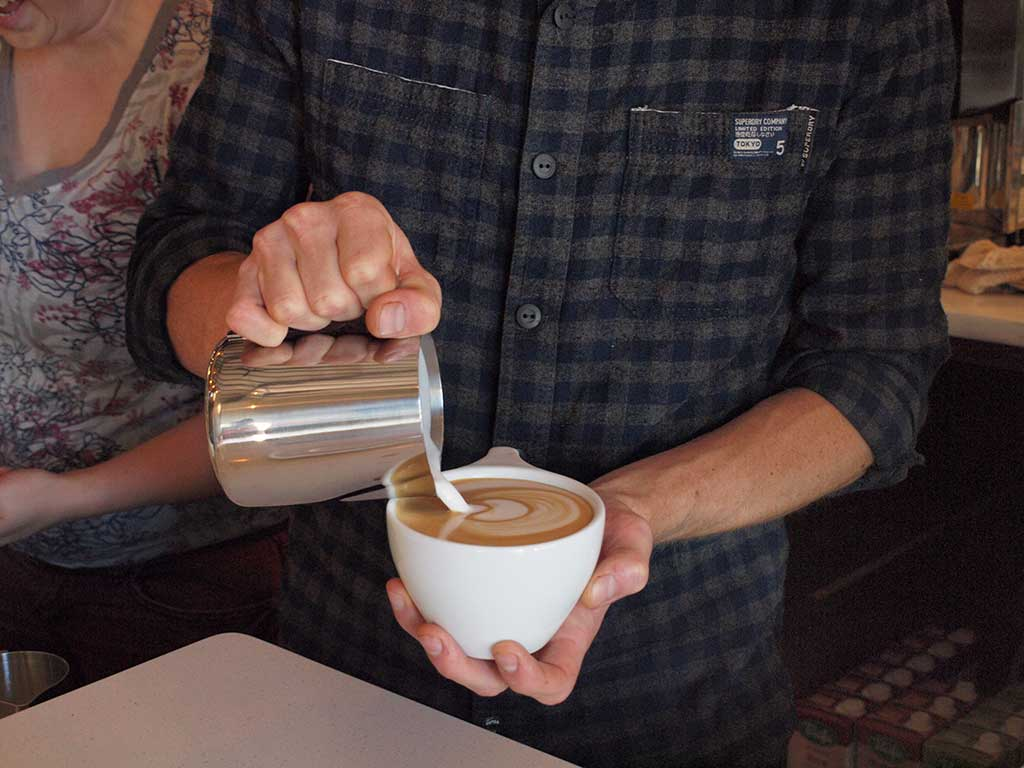 Pouring a latte at Case Study Coffee on Albert Street in Portland, Oregon